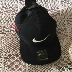 New with tags black Nike hat with Crossland emblem